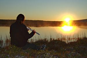 The flute player facing the midnight sun.