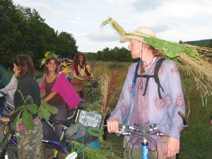 Some biketour cyclists dressed according to the theme flying just before arriving to Ecotopia