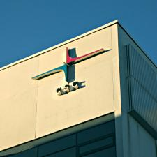 A corner of the CSC building with the company logo in morning light.