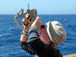 Helen practising the use of a sextant.