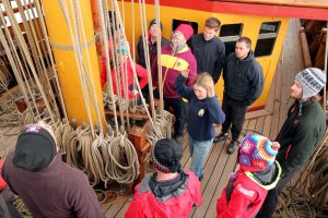 Learning how the ropes are connected to the sails.