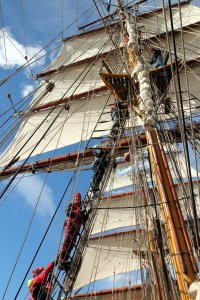 Practising climbing up the mast.