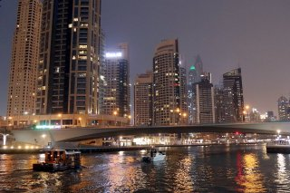 High-rise buildings at the Dubai Marina at night.