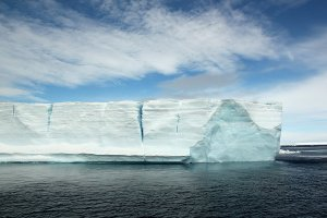 A large tabular iceberg with some cracks.