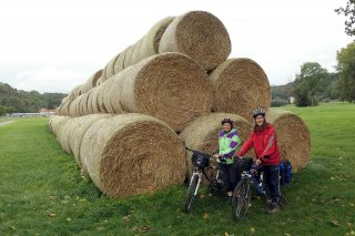 Huge straw rolls next to the Elbe river cycling route.