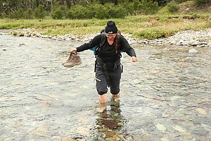 Sandra crossing one of the small rivers.