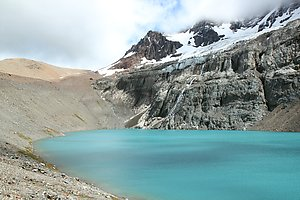 The mountain lake being fed with glacier water.
