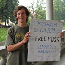 Me with a free hugs sign in Ljubljana, Slovenia.