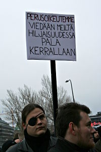 A sign saying (translation): Our basic rights are being taken away from us in silence, piece by piece.