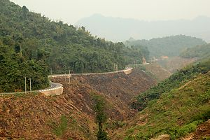 A mountain road near Na Mor, Oudomxay, Laos. Visibility reduced due to the misty air.