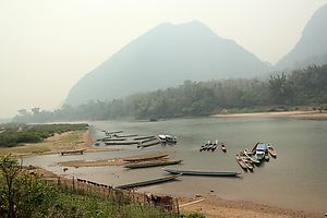 River boats on the Nam Ou river, in front of the Muang Ngoi village.